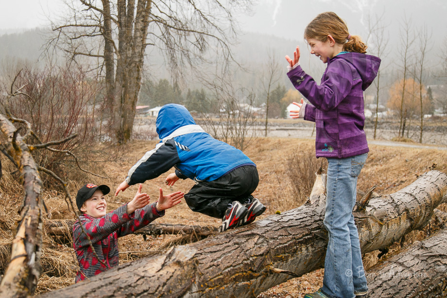 Kids Jumping off Log