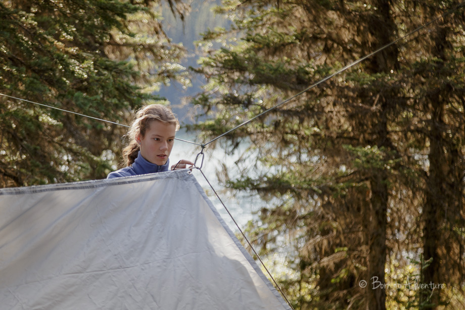 Setting up a tarp of camping